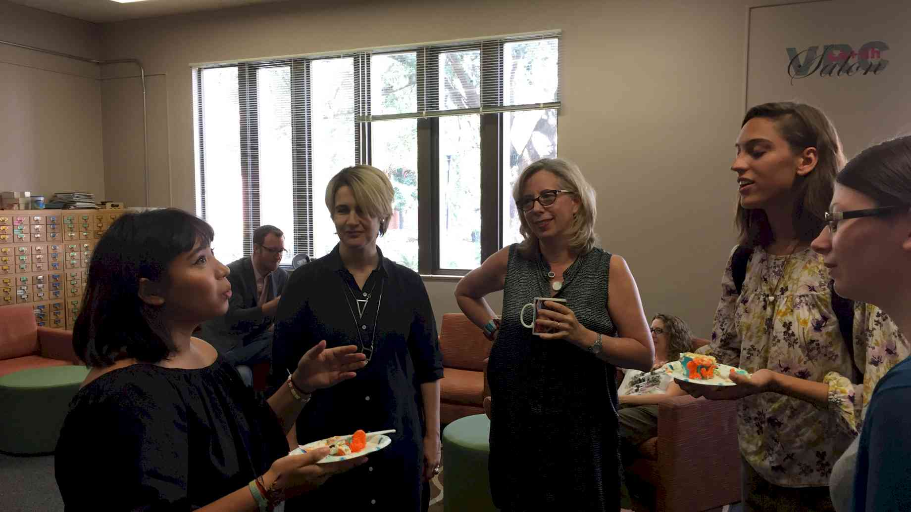 Profs Cabanas and Hyde with students at annual Cake & Conviviality reception for new majors