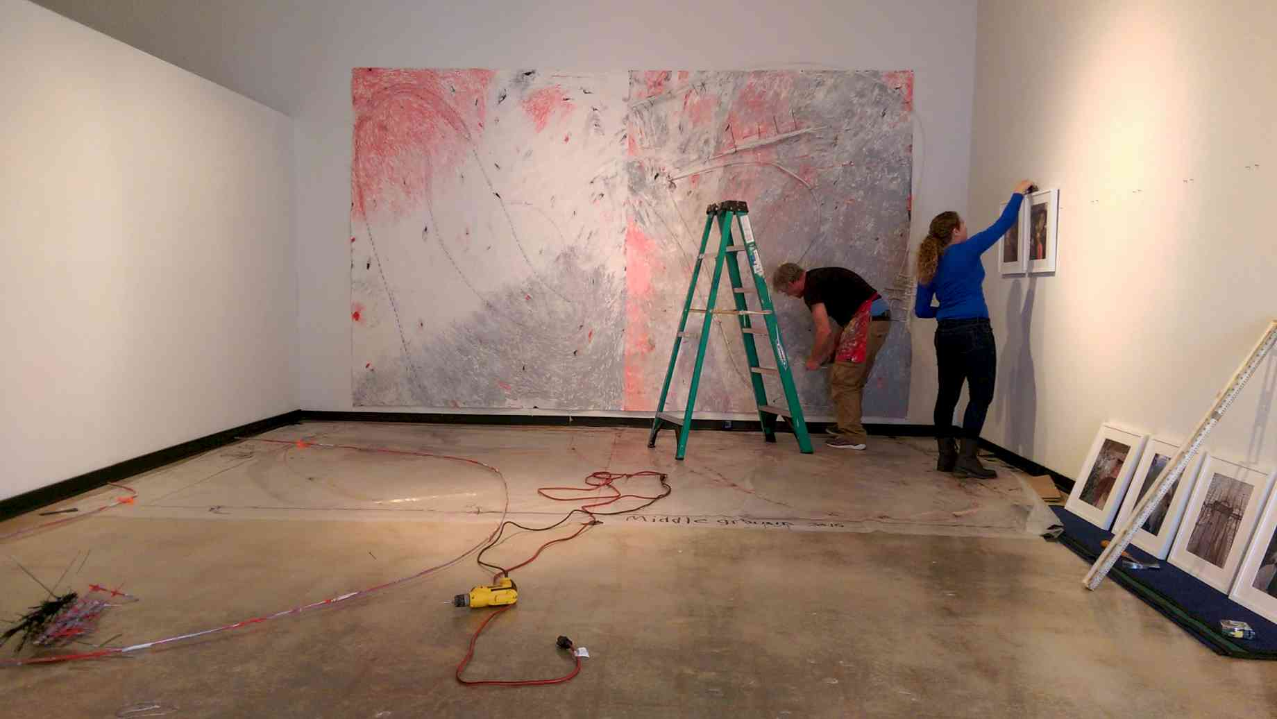 Alumna Kaitlin Hof-Mahoney installs at the Unviersity Gallery.