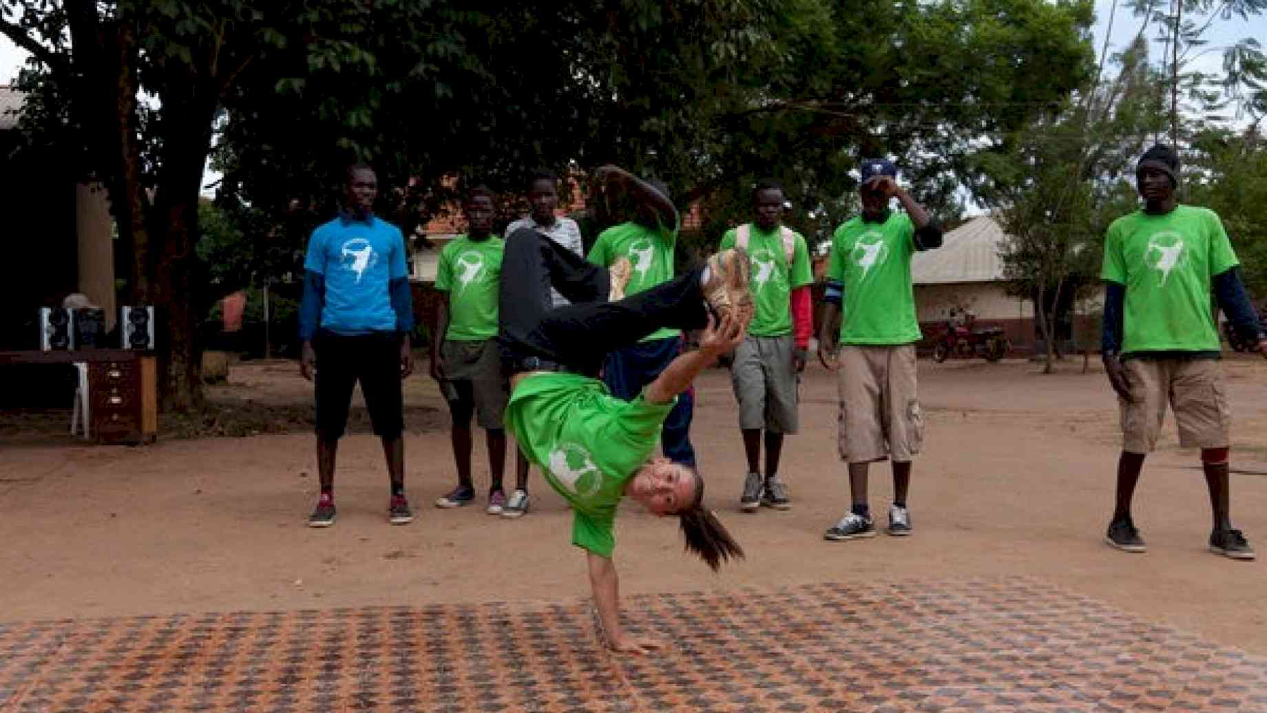 A Peace Corps volunteer in Uganda works with a breakdancing group of girls in her community.