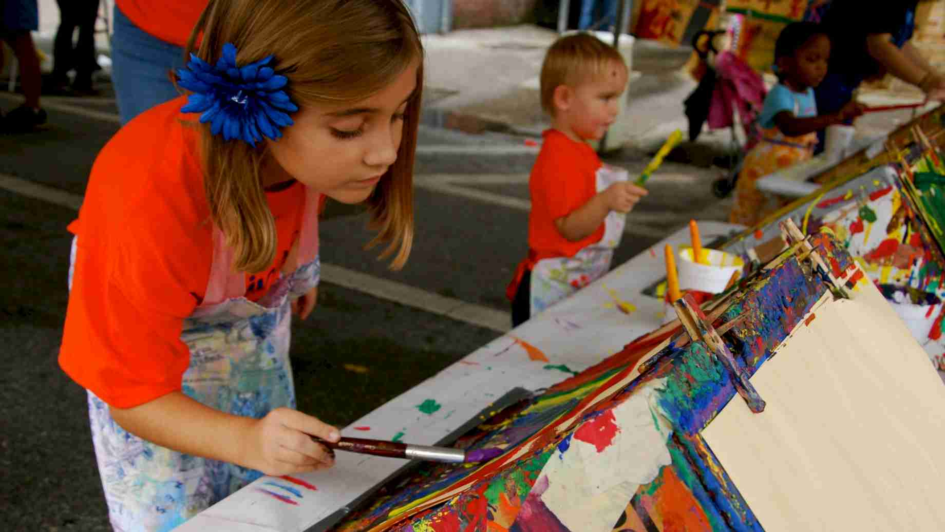 The painting easels are always a popular activity area at the annual Imagination Station sponsored by the UF Art Education program each Fall.