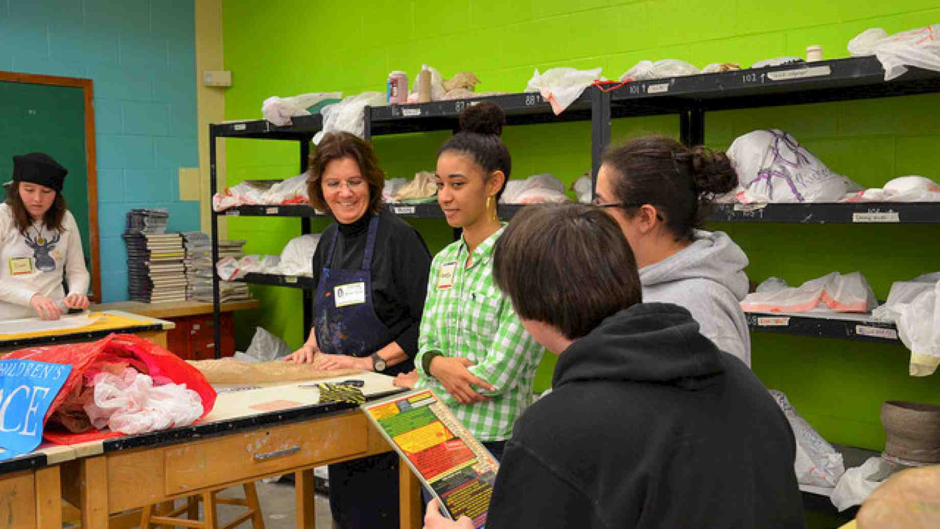 Art education faculty member, Michelle Tillander working with local high school students during a field experience