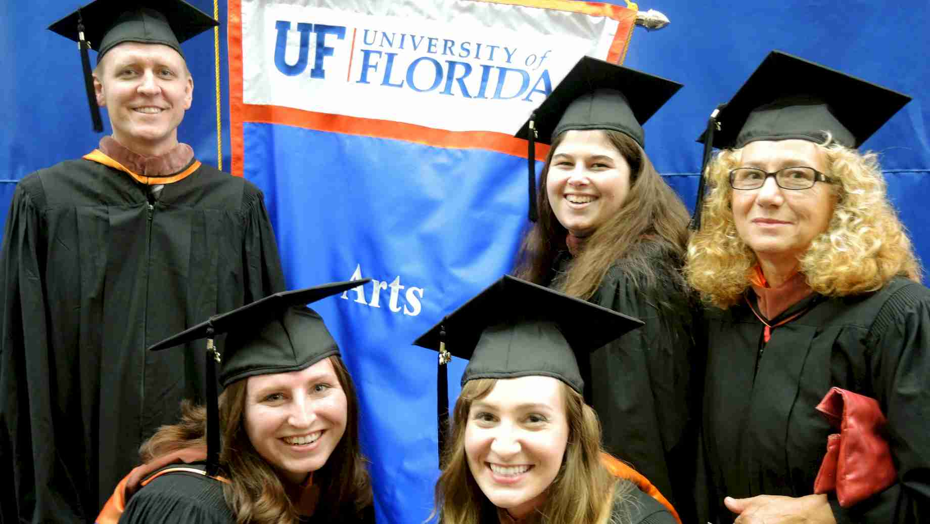 Some of our graduates from the Online MA program in art education participating in commencement activities on campus.