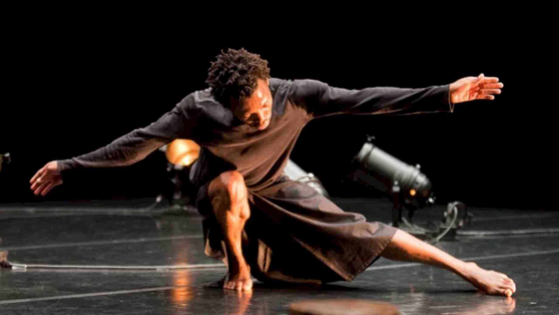 "Faustin Linyekula rekindling an ""idea of dance...just before or after a story,"" ""Le Cargo."""