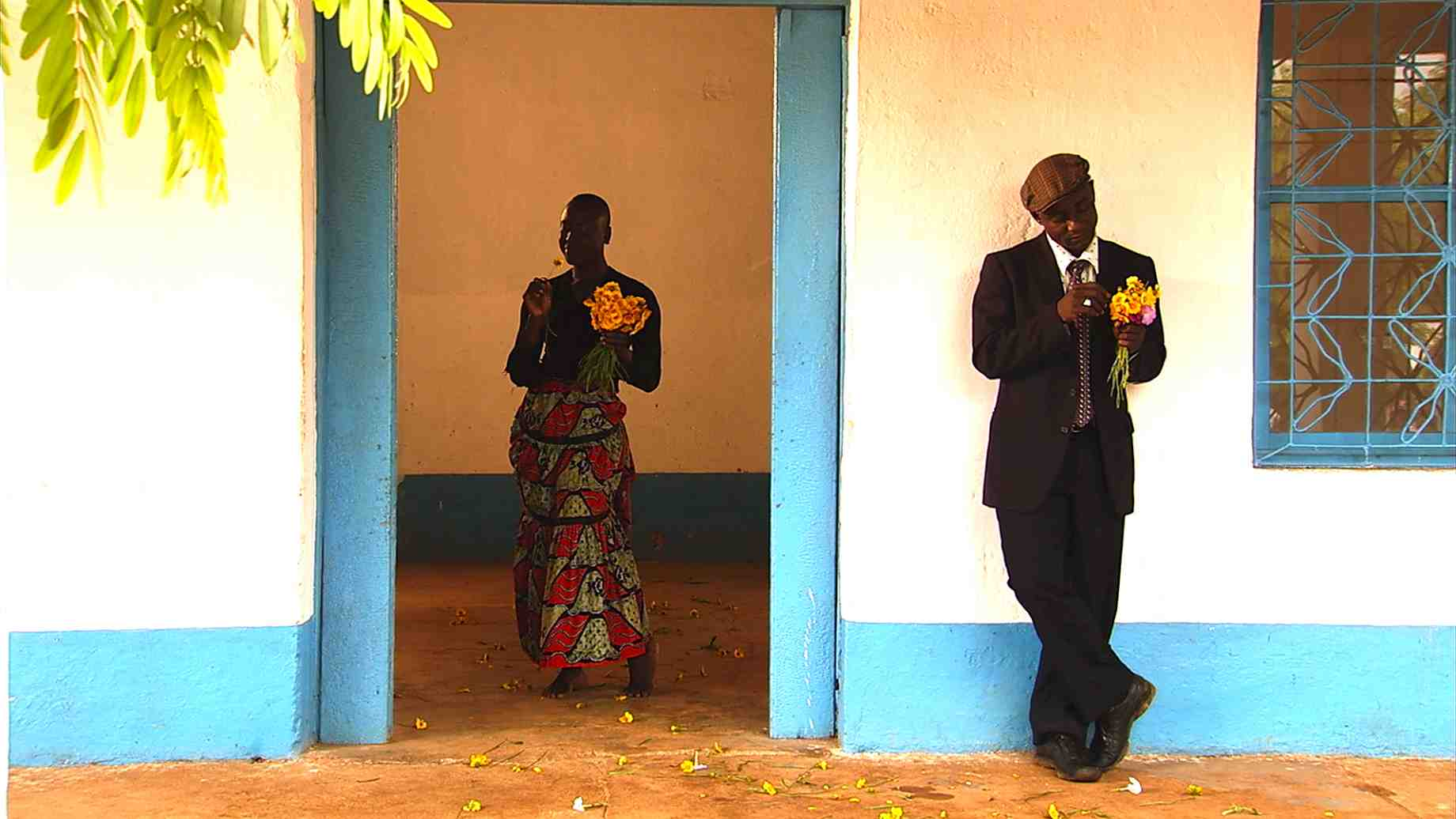 Souleymane Badolo, in NORA, wooing the heart of Nora with flowers and poetry.