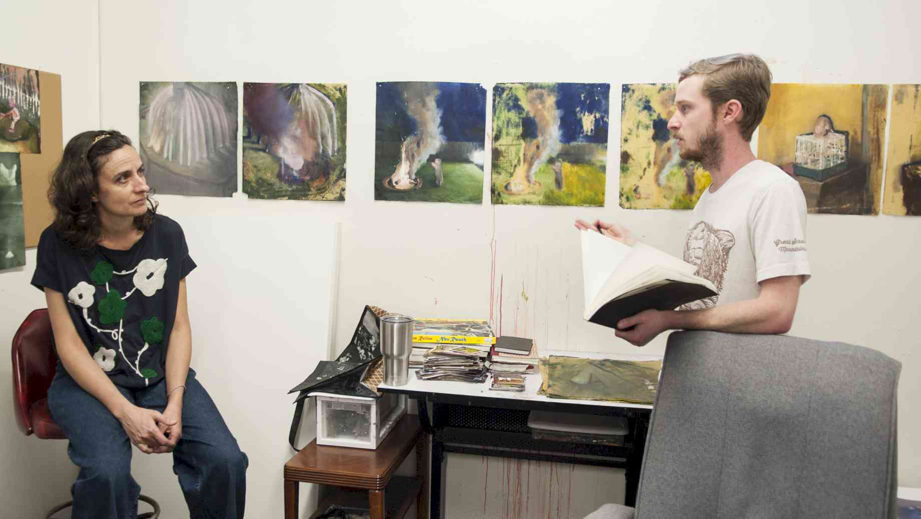 Visiting Artist Eileen Quinlan conducts a studio visit with Painting grad Franklin Ratliff